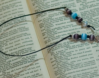 Cat's eye fiber optic beaded bookmark in purple and aqua, hardback size