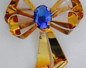 Antique Brooch gold over sterling bow, stone in center 16.4 gr. blue cabochon, vermeil sterling