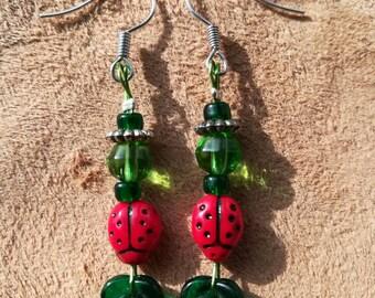 Ladybird and leaf earrings.