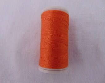 Spool of sewing thread, orange, special machine (523)