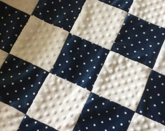 A patchwork in navy and white polka dot minky blanket  , the back is a white minky dot.