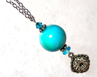 Aqua bead and flower charm pendant necklace