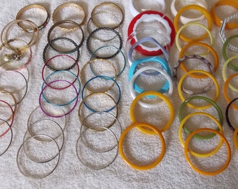 Lot 50 cuff bracelets, narrow widths, continuous, pre owned estate lot unworn/gently used, metals and acrylic/plastics