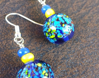 pretty navy glass bead with smaller yellow & blue bead on silver ear wire