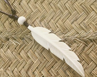 Leather Collar and feather carved in bone.