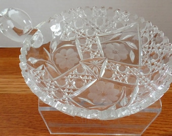 Vintage one handle glass dish, with etched & frosted flowers.  No Mark.  Very good condition.