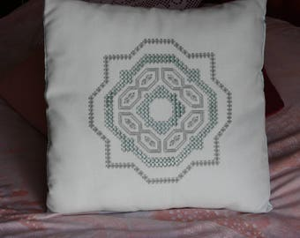 Handmade turquoise embroidery pillow