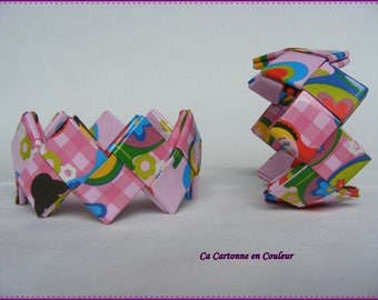 Pink bracelet closed recycled background paper