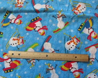 1.5 Yards/54 Inches Blue with Snowmen Skiing/Sledding Cotton Fabric