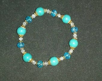 Blue turquoise magnesite, gold, and crystal stretch bracelet