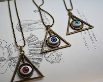 Triangle and eye cabochon pendant