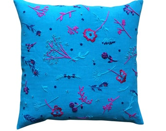 Meadow cushion, blue, turquoise and pink on aqua turquoise linen