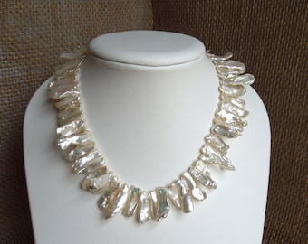 Freshwater Pearl Knotted Necklace - Freshwater Biwa Stick Pearls, Silk, Fine Silver Flower Clasp