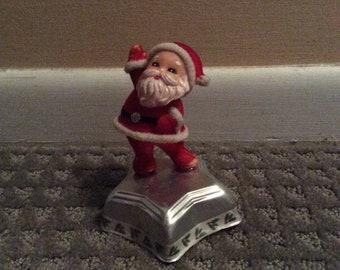 Santa reaching for the stars