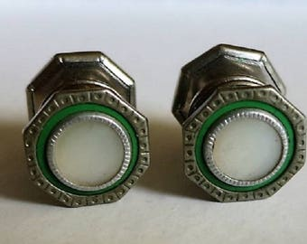 A Pair of Mismatched Snap Cufflinks