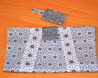 Door checkbook and a keychain for grey Origami chips
