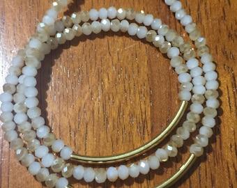 Triple strand bracelet with 2/gold filled tubes