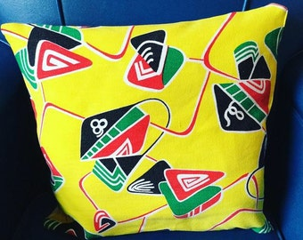 Pair of 50s atomic fabric cushions