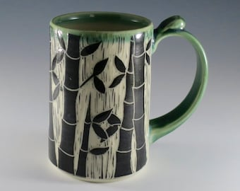 Wheel-thrown, green glazed hand-carved tankard with bamboo design