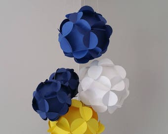 Suspension of five 3D paper balls.