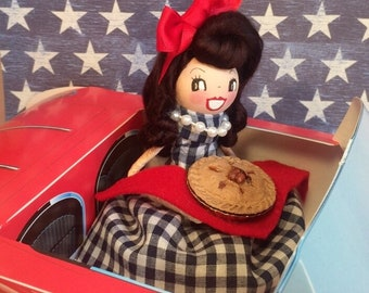 American girl with apple pie red 1958 Ford Thunderbird convertable vintage atomic retro inspired doll ornament red white blue centerpiece