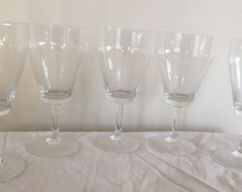A set of five etched atomic era small wine glasses.