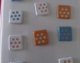 set of 12 brads in form square with small flowers made of dots
