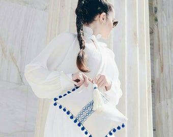 Boho chic wristlet clutch with pom poms. Ethnic summer clutch. Hippie style pom pom bag. Grecian clutch. Blue white summer clutch.