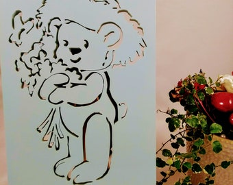 Picture of a teddy with flowers