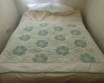Quilt single bed cover or double bed topper, sofa throw. Wholecloth quilt in floral theme fabric in white/aqua.  Handquilted.  Great gift.