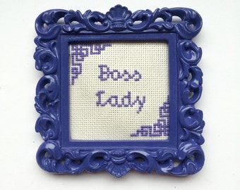 Framed Boss lady cross stitch.