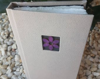 White journal with wooden flower button