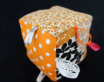 Baby Orange patterns play cube various ribbons galore - baby 3 months