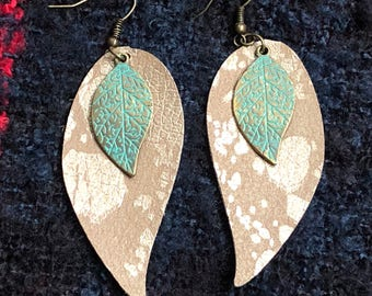 Splatter gold leather earrings.  Leaf with green gold leaf dangle.