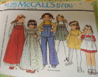 McCall's 5786 Girl's Dress, Pinafore, Jumper Pattern Size 4 Partially uncut