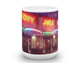 Ceramic mug depicting the original digital painting by Floridafred. Mug made in the USA