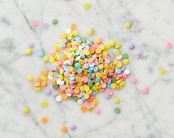 Confetti sprinkles, multi-colored pastel disks, perfect for cakes and cupcakes