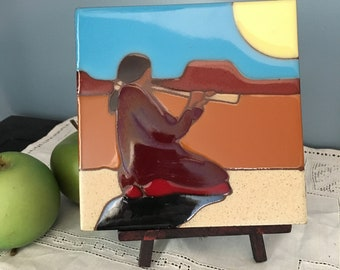 Mexican woman playing flute tile