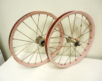 vintage pink girls bicycle wheels rims spokes parts,yard rusty bicycle,kids children old bicycle,garden yard decor wheels