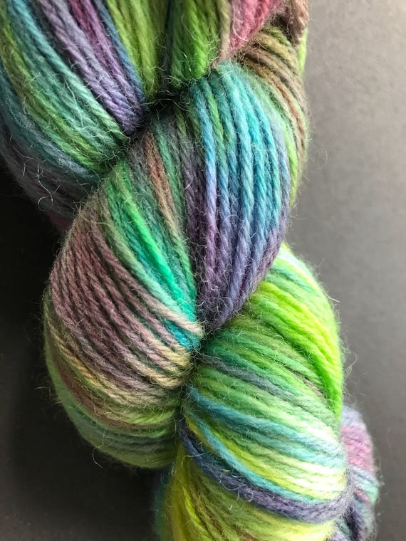 Hand dyed fine wool yarn 'made by Sjors' in green, purple and yellow
