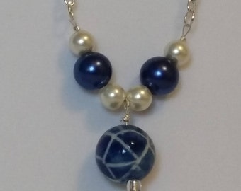 Blue ball with blue pearls