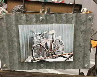 Industrial look mounted bicycle photo