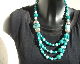 shades of turquoise multi strand necklace, silver mounted.