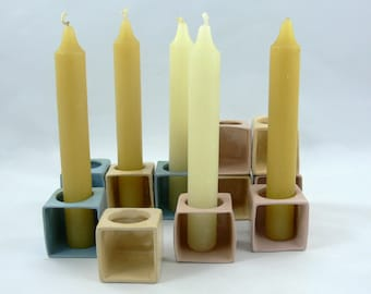 Candlesticks and candelabra cube of colors