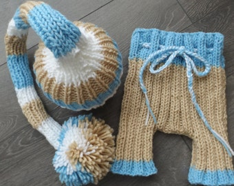long hat with large Pompom to photograph your newborn