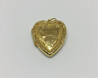 Vintage gold heart shaped locket