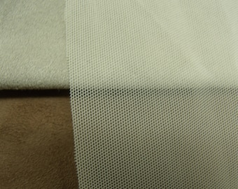 Fabric mesh white BREAKAGE, 150 cm, ideal for making a skirt or a sur-tee shirt, very fashionable this spring / summer