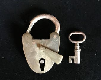 Small antique brass padlock and key.
