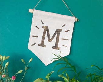 "Wall banner with the magic letter ""M"""