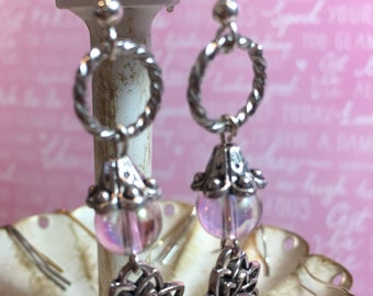 Opalescent pink earrings with silver and pink  accents.